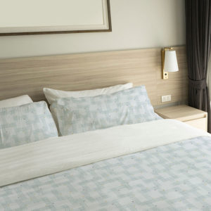 Asian Plaid Pattern P79 in Blue Color on a Hotel Bed