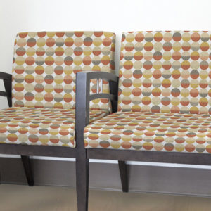 Ikat Circles Pattern P24 in Coral as Upholstery on Reception Seating for Healthcare